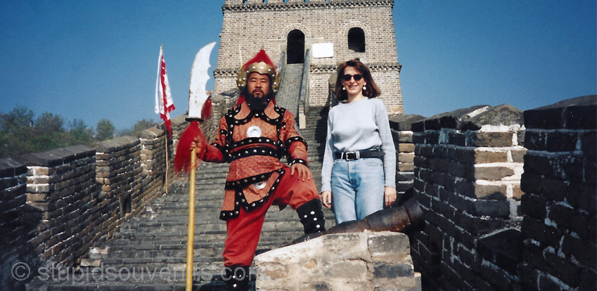 Standing on the great wall of china with am authentic looking great wall guard.