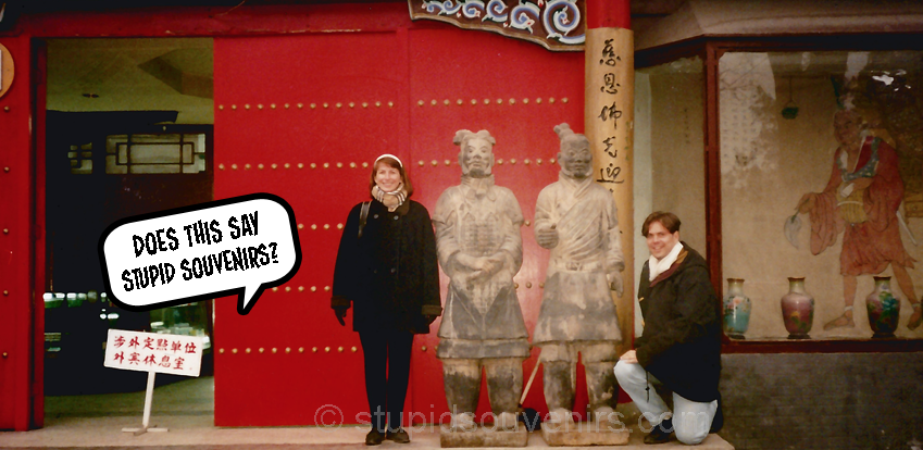 Tourists posing with terra-cotta army figures in Xian, China.
